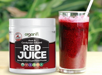 Glass of Red Juice by Organifi